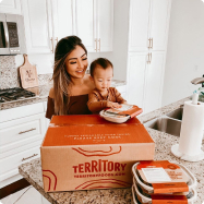 Mother and child with Territory box