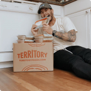 Man sitting next to Territory delivery